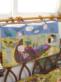 My quilt  in...bonnet  with a parasol
