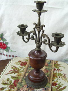 In the movie... antique bronze  candle holder  (USA)